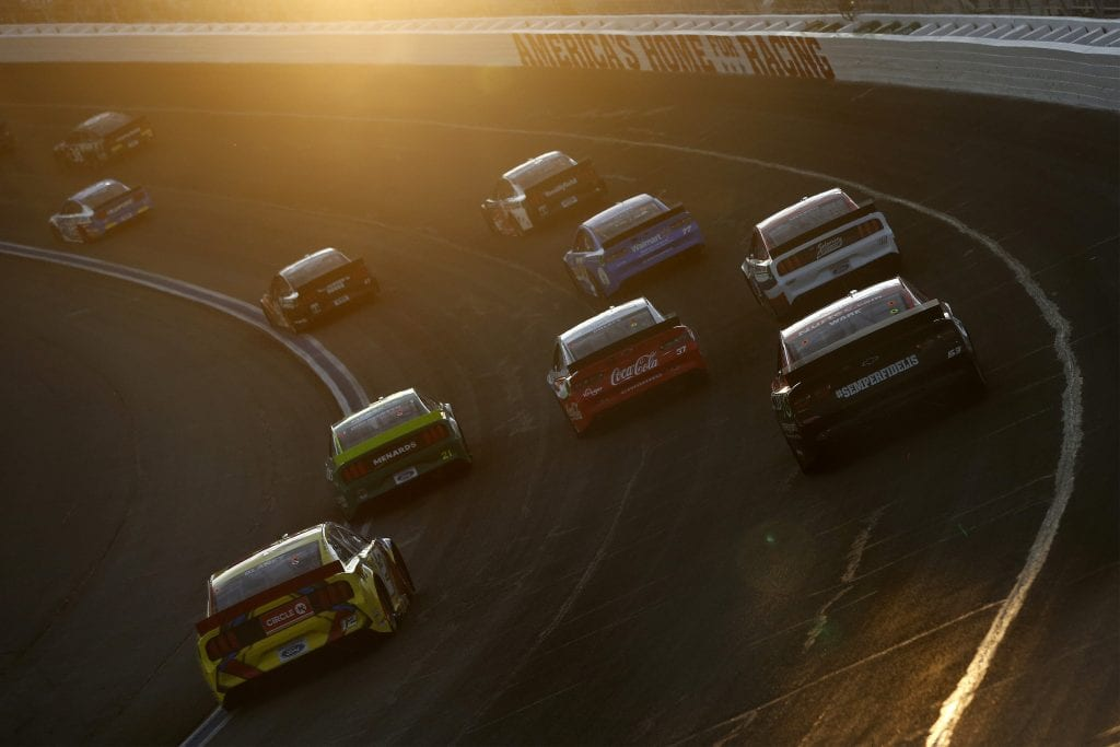 CONCORD, NORTH CAROLINA - MAY 30: Cars race as the sun sets during the NASCAR Cup Series Coca-Cola 600 at Charlotte Motor Speedway on May 30, 2021 in Concord, North Carolina. (Photo by Brian Lawdermilk/Getty Images) | Getty Images