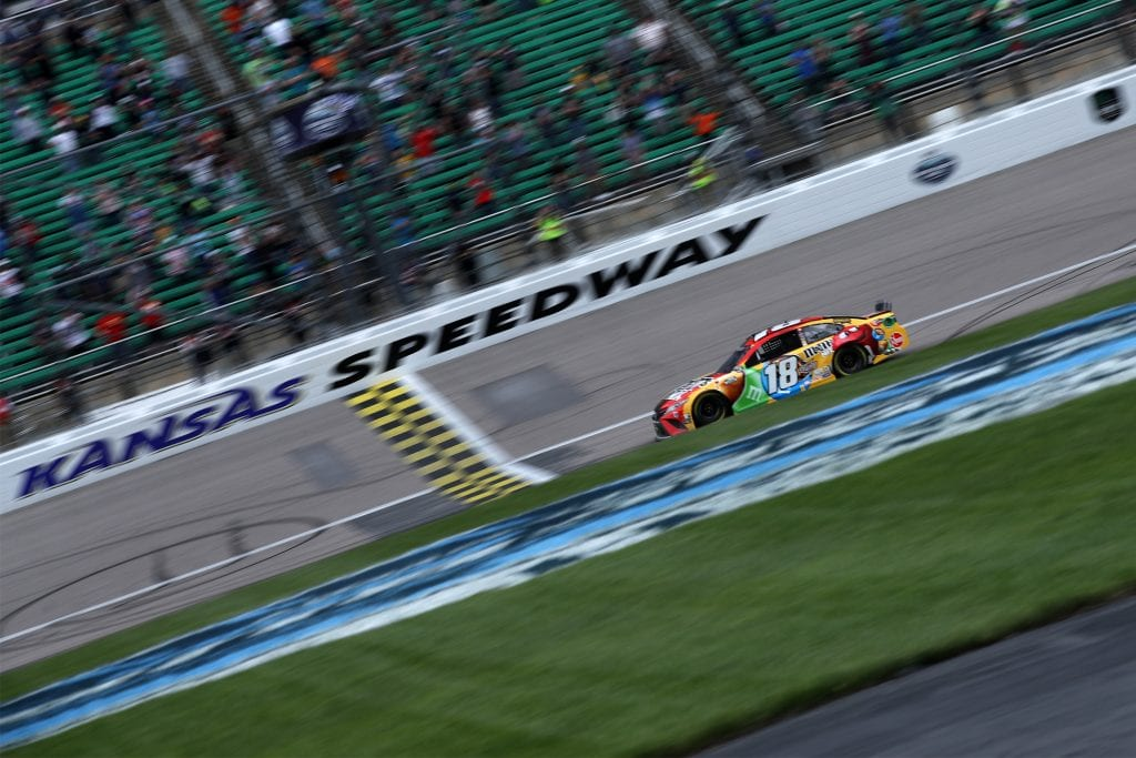 KANSAS CITY, KANSAS - MAY 02: Kyle Busch, driver of the #18 M&M's Mix Toyota, crosses the finish line to win the NASCAR Cup Series Buschy McBusch Race 400 at Kansas Speedway on May 02, 2021 in Kansas City, Kansas. (Photo by Sean Gardner/Getty Images) | Getty Images
