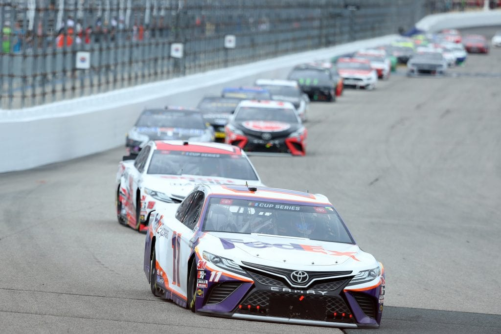 LOUDON, NEW HAMPSHIRE - AUGUST 02: Denny Hamlin, driver of the #11 FedEx Express Toyota, leads the field during the NASCAR Cup Series Foxwoods Resort Casino 301 at New Hampshire Motor Speedway on August 02, 2020 in Loudon, New Hampshire. (Photo by Maddie Meyer/Getty Images) | Getty Images