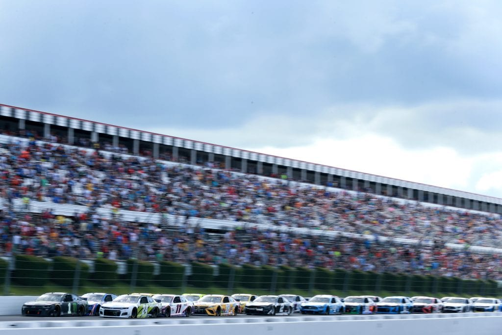 LONG POND, PENNSYLVANIA - JUNE 26: Kurt Busch, driver of the #1 Monster Energy Chevrolet, and William Byron, driver of the #24 Axalta Color of the Year Chevrolet, lead the field during the NASCAR Cup Series Pocono Organics CBD 325 at Pocono Raceway on June 26, 2021 in Long Pond, Pennsylvania. (Photo by Sean Gardner/Getty Images)   Getty Images