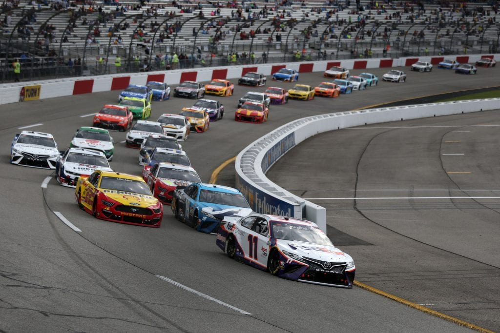 RICHMOND, VIRGINIA - APRIL 18: Denny Hamlin, driver of the #11 FedEx Express Toyota, leads the field during the NASCAR Cup Series Toyota Owners 400 at Richmond Raceway on April 18, 2021 in Richmond, Virginia. (Photo by Brian Lawdermilk/Getty Images) | Getty Images
