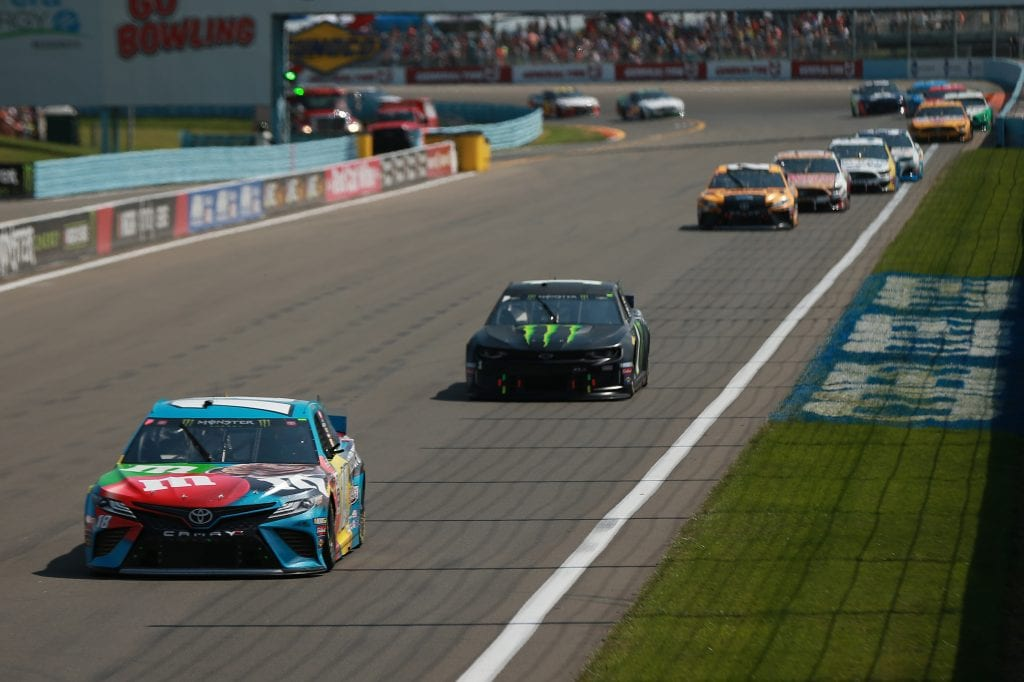 WATKINS GLEN, NEW YORK - AUGUST 04: Kyle Busch, driver of the #18 M&M's Hazelnut Toyota, leads a pack of cars during the Monster Energy NASCAR Cup Series Go Bowling at The Glen at Watkins Glen International on August 04, 2019 in Watkins Glen, New York. (Photo by Sean Gardner/Getty Images) | Getty Images