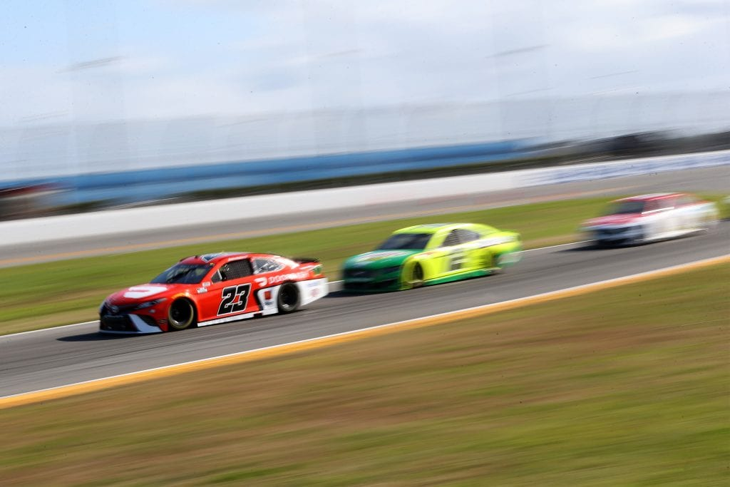 DAYTONA BEACH, FLORIDA - FEBRUARY 21: Bubba Wallace, driver of the #23 DoorDash Toyota, drives during the NASCAR Cup Series O'Reilly Auto Parts 253 at Daytona International Speedway on February 21, 2021 in Daytona Beach, Florida. (Photo by Brian Lawdermilk/Getty Images)   Getty Images