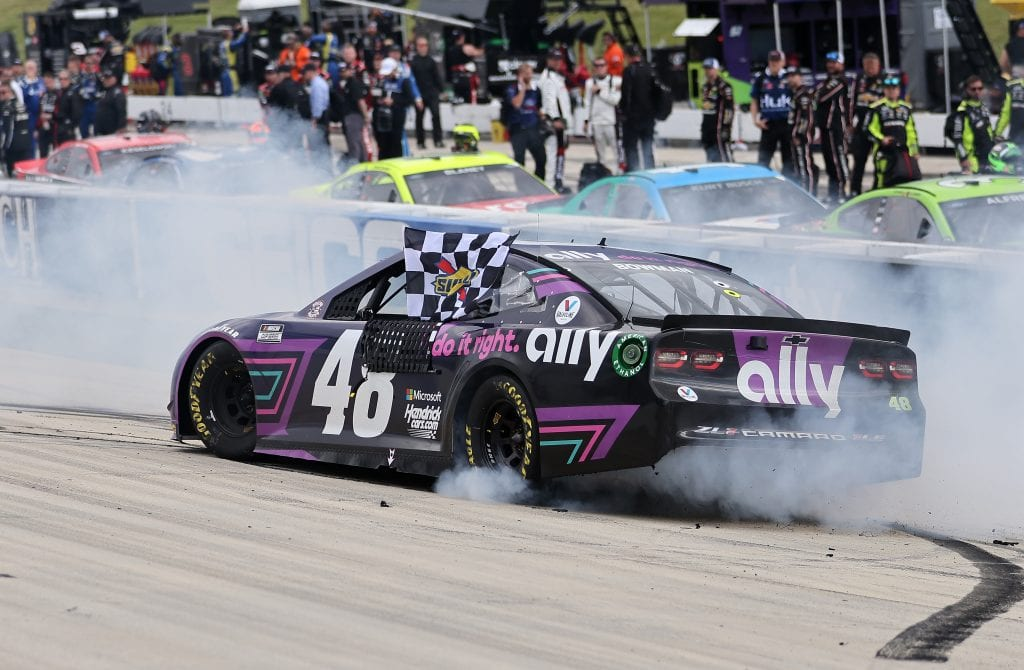 DOVER, DELAWARE - MAY 16: Alex Bowman, driver of the #48 Ally Chevrolet, does a burnout after winning the NASCAR Cup Series Drydene 400 at Dover International Speedway on May 16, 2021 in Dover, Delaware. (Photo by James Gilbert/Getty Images)   Getty Images