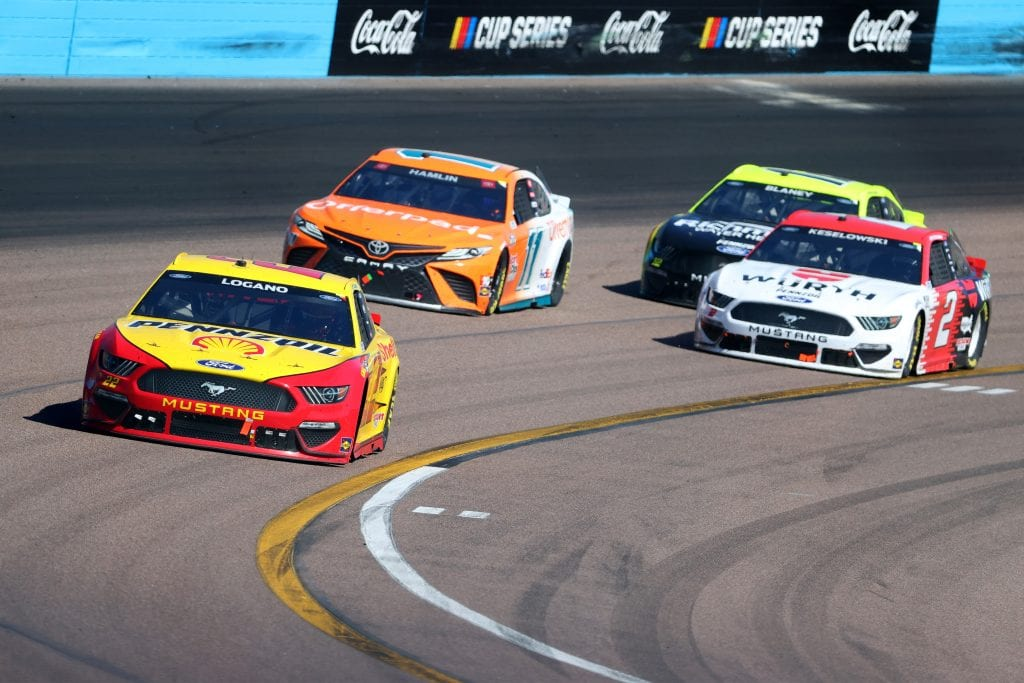 AVONDALE, ARIZONA - MARCH 14: Joey Logano, driver of the #22 Shell Pennzoil Ford, Denny Hamlin, driver of the #11 Offerpad Toyota, and Brad Keselowski, driver of the #2 Wurth Ford, race during the NASCAR Cup Series Instacart 500 at Phoenix Raceway on March 14, 2021 in Avondale, Arizona. (Photo by Abbie Parr/Getty Images)   Getty Images