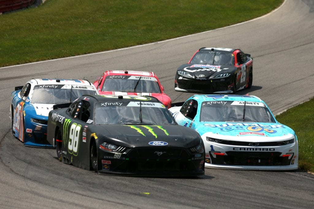 LEXINGTON, OHIO - JUNE 05: Riley Herbst, driver of the #98 Monster Energy Ford, Alex Labbe, driver of the #36 Prolon/rosseau/Silver Wax Chevrolet, Michael Annett, driver of the #1 Pilot Flying J Summer is a Go Chevrolet, Brett Moffitt, driver of the #02 Our Motorsports Chevrolet, and Kris Wright, driver of the #26 America's Auto Auction Toyota, race during the NASCAR Xfinity Series B&L Transport 170 at Mid-Ohio Sports Car Course on June 05, 2021 in Lexington, Ohio. (Photo by Sean Gardner/Getty Images)   Getty Images