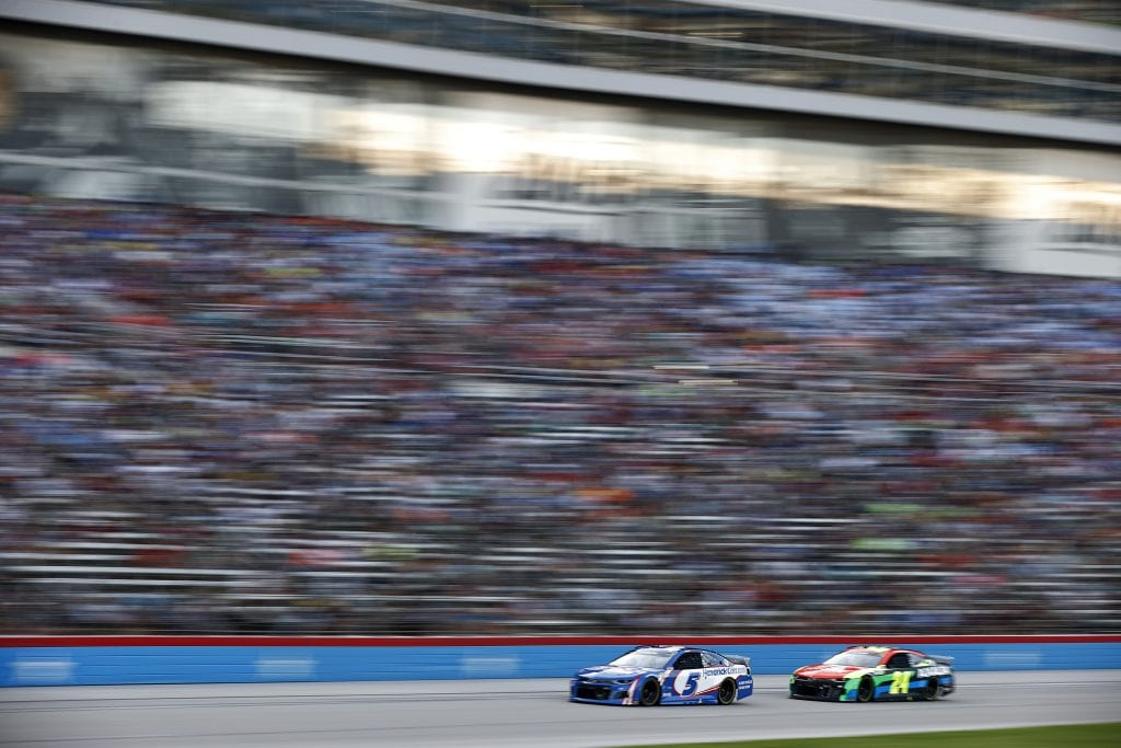 FORT WORTH, TEXAS - JUNE 13: Kyle Larson, driver of the #5 HendrickCars.com Chevrolet, and William Byron, driver of the #24 Axalta Chevrolet, race during the NASCAR All-Star Race at Texas Motor Speedway on June 13, 2021 in Fort Worth, Texas. (Photo by Jared C. Tilton/Getty Images) | Getty Images
