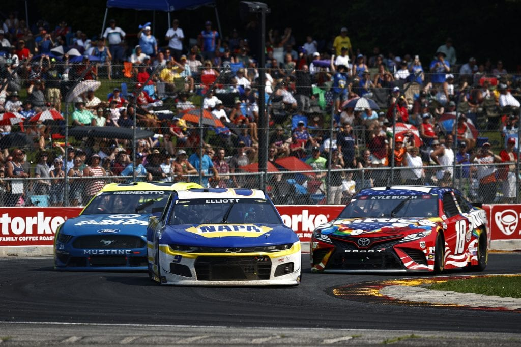 ELKHART LAKE, WISCONSIN - JULY 04: Chase Elliott, driver of the #9 NAPA Auto Parts Chevrolet, Matt DiBenedetto, driver of the #21 Menards/Dutch Boy Ford, and Kyle Busch, driver of the #18 Skittles Red White & Blue Toyota, race during the NASCAR Cup Series Jockey Made in America 250 Presented by Kwik Trip at Road America on July 04, 2021 in Elkhart Lake, Wisconsin. (Photo by Jared C. Tilton/Getty Images)   Getty Images