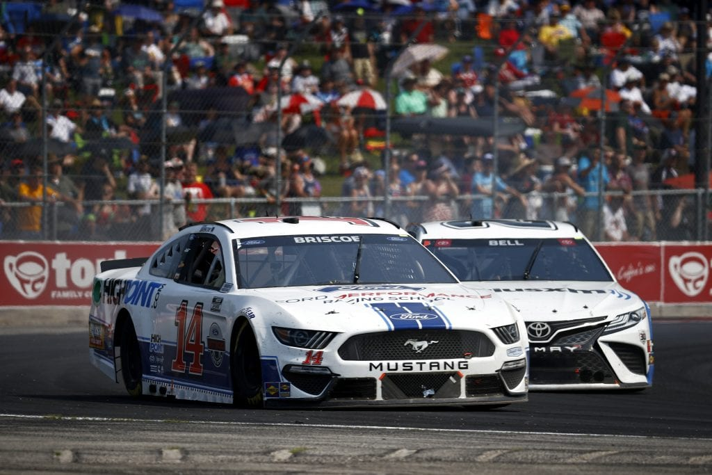 ELKHART LAKE, WISCONSIN - JULY 04: Chase Briscoe, driver of the #14 FordPerformanceRacingSchool/HighPoint Ford, and Christopher Bell, driver of the #20 Sirius XM Toyota, race during the NASCAR Cup Series Jockey Made in America 250 Presented by Kwik Trip at Road America on July 04, 2021 in Elkhart Lake, Wisconsin. (Photo by Jared C. Tilton/Getty Images)   Getty Images