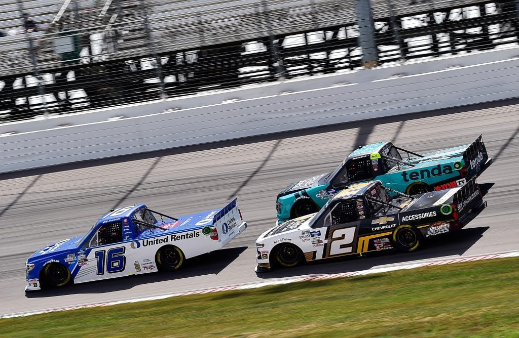 MADISON, ILLINOIS - AUGUST 30: Austin Hill, driver of the #16 United Rentals Toyota, Sheldon Creed, driver of the #2 Chevy Accessories Chevrolet, and Ben Rhodes, driver of the #99 Tenda Ford, race during the NASCAR Gander Outdoors Truck Series CarShield 200 Presented by CK Power on August 30, 2020 in Madison, Illinois. (Photo by Jeff Curry/Getty Images)   Getty Images